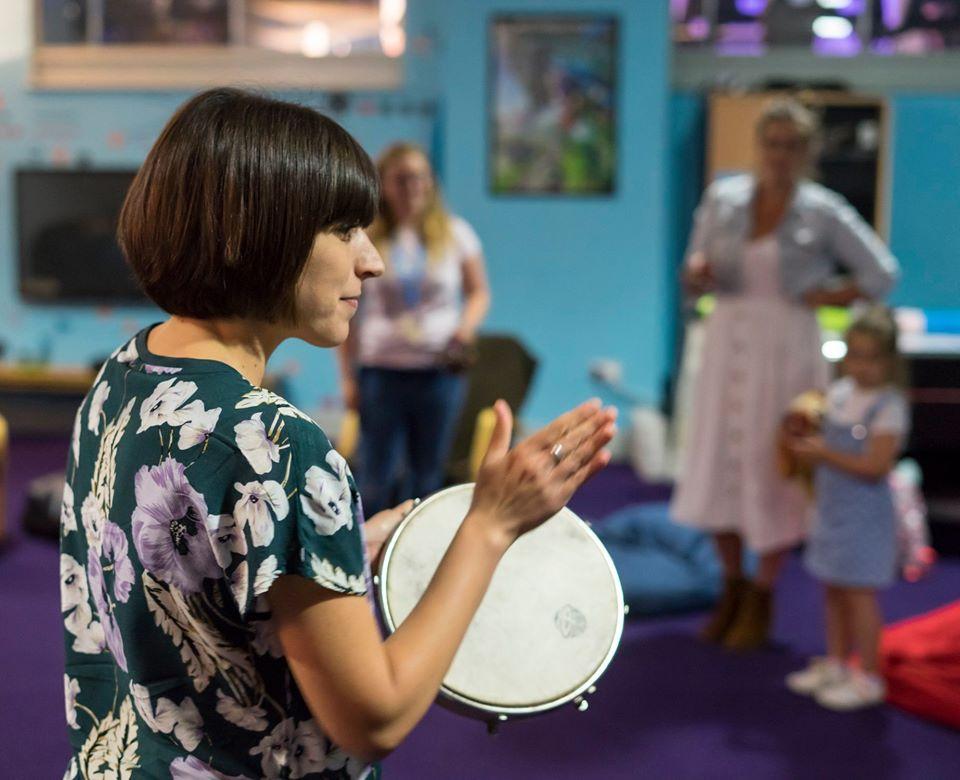 Laura playing the tambourine